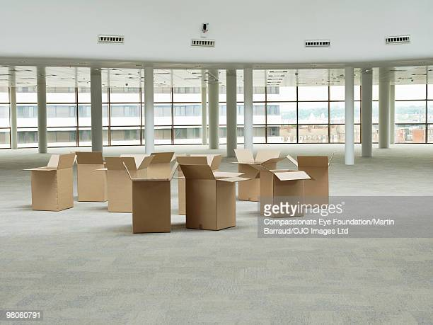 a bunch of empty boxes in a large empty room