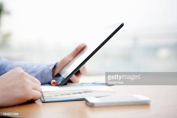 a business woman using a digital tablet