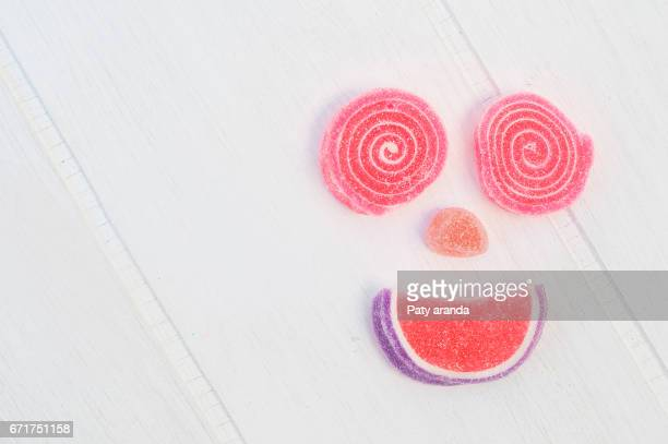 a candy smiling