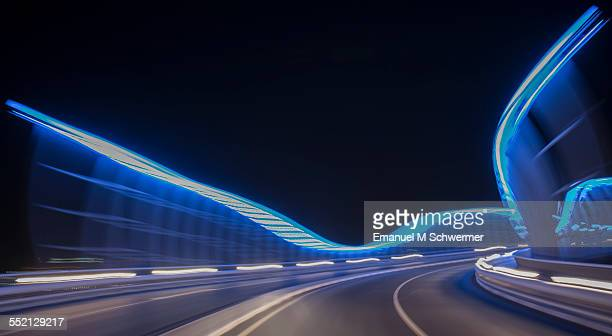 POV of a car / driving over illuminated bridge