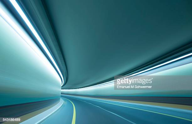 POV of a car driving through a tunnel.