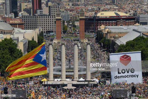 a Catalan proindependence 'estelada' flag flutters as thousands of people participate in a demonstration dubbed 'Referendum is Democracy' organized...