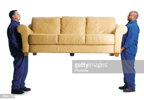 a caucasian male and an african american male mover carry a couch together