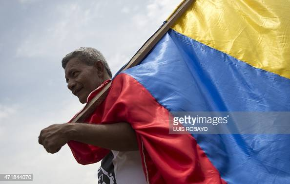 a Colombian worker demonstrates during May Day celebration in Cali Colombia on May 1 2015 AFP PHOTO/LUIS ROBAYO