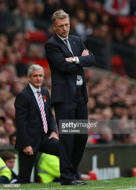a dejected Manager David Moyes of Manchester United looks on during the Barclays Premier League match between Manchester United and Stoke City at Old...