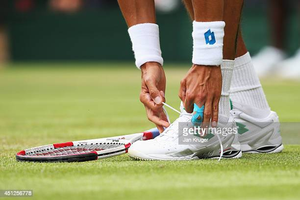 a detail shot of Lukas Rosol of Czech Republic tying his shoelace during his Gentlemen's Singles second round match against Rafael Nadal of Spain on...