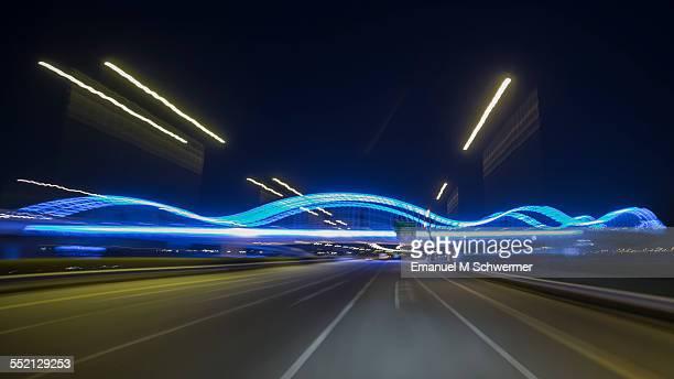 POV of a driving car approaching a bridge
