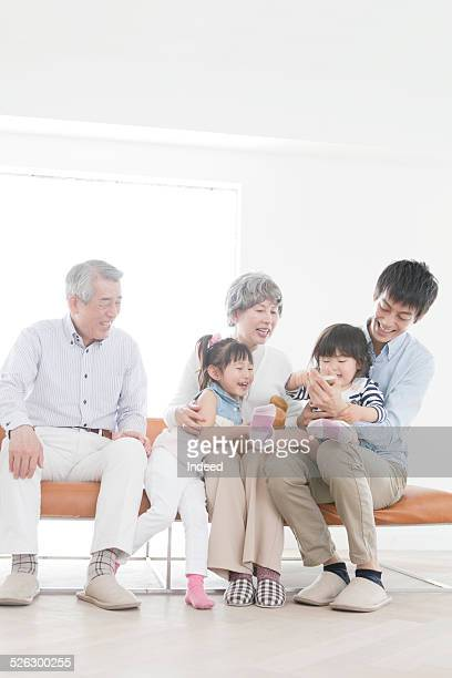 a family sitting on a sofa