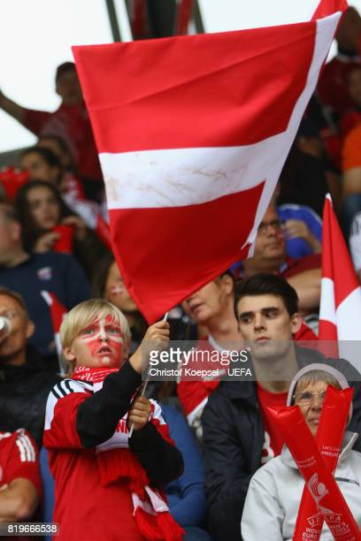 a fan of Denmark waves a flag prior to the UEFA Women's Euro 2017 Group A match between Netherlands and Denmark at Sparta Stadion on July 20 2017 in...