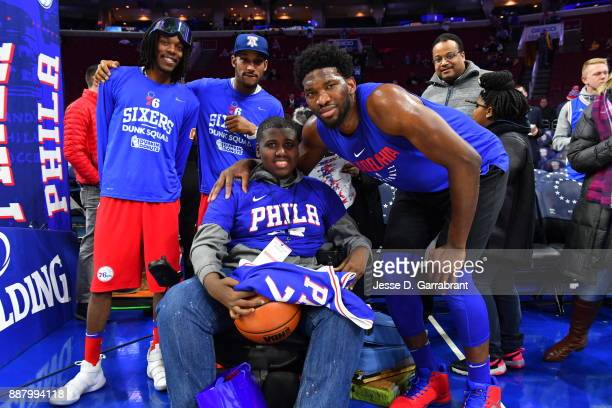 a fan poses for a picture with Joel Embiid of the Philadelphia 76ers before the game against the Los Angeles Lakers on December 7 2017 at Wells Fargo...