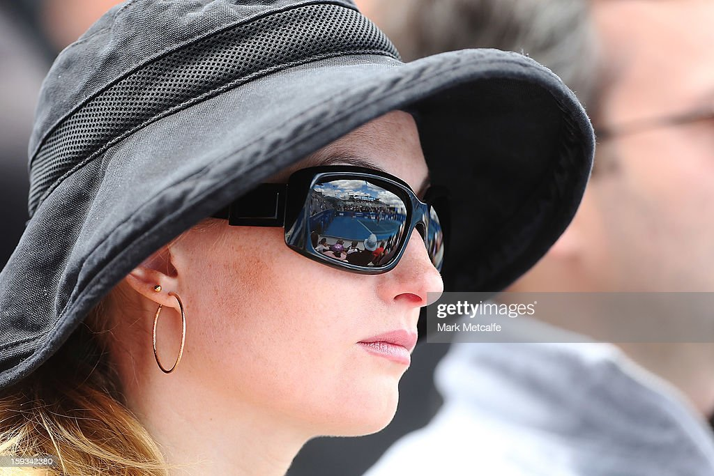 a fan watches the Women's singles final match between Elena Vesnina of Russia and Mona Barthel of Germany during day nine of the Hobart International at Domain Tennis Centre on January 12, 2013 in Hobart, Australia.