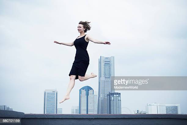 a female jumping in the city scape