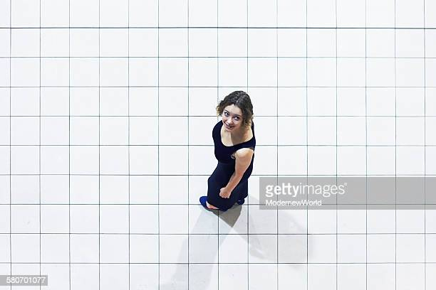 a female looking up and smiling on the grid