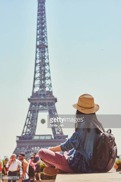 a female tourist looking at Eiffel Tower