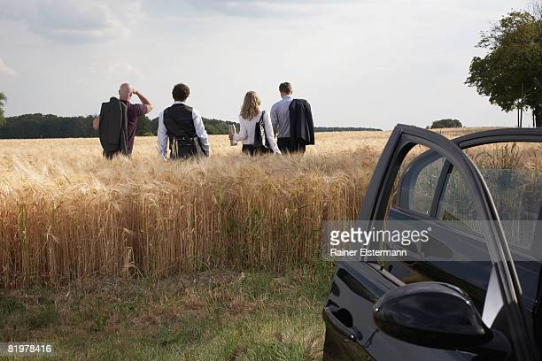 a few people on a business trip with car
