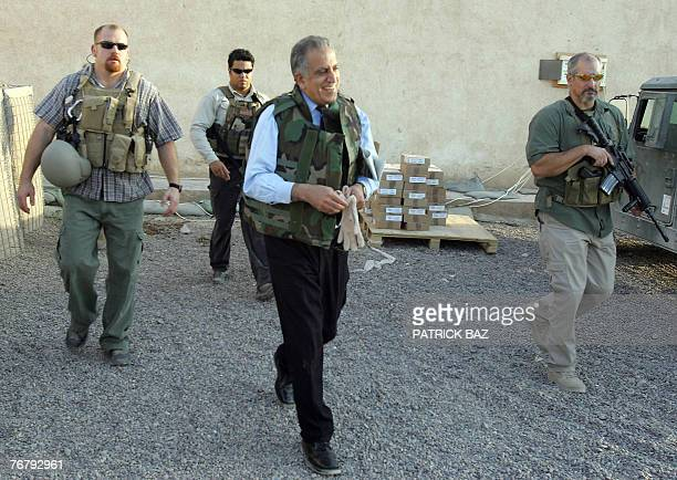a file picture dated 15 October 2005 shows US Ambassador to Iraq Zalmai Khalilzad wearing a flack jacket and surrounded by bodyguards from the US...