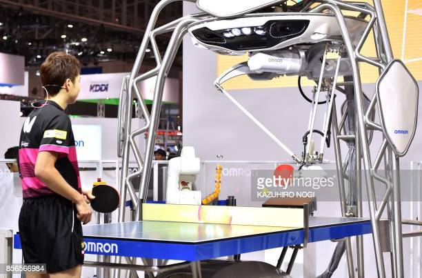 FORPHEUS a fourthgeneration tabletennis robot developed by automation parts maker Omron returns a shot to Japan's Olympic medallist Jun Mizutani...