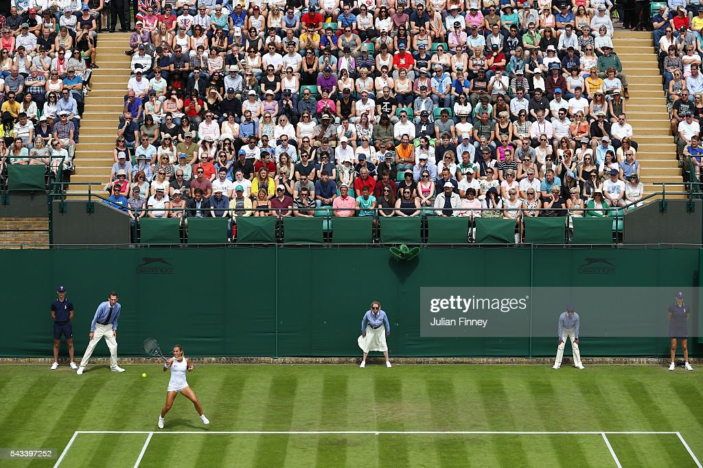 a general view of supporters watching on as <a gi-track='captionPersonalityLinkClicked' href=/galleries/search?phrase=Dominika+Cibulkova&family=editorial&specificpeople=4091238 ng-click='$event.stopPropagation()'>Dominika Cibulkova</a> of Slovakia plays a forehand during the LadiesSingles first round match against Mirjana Lucic-Baroni of Croatia on day two of the Wimbledon Lawn Tennis Championships at the All England Lawn Tennis and Croquet Club on June 28, 2016 in London, England.