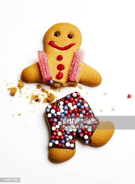 a gingerbread man broken in half