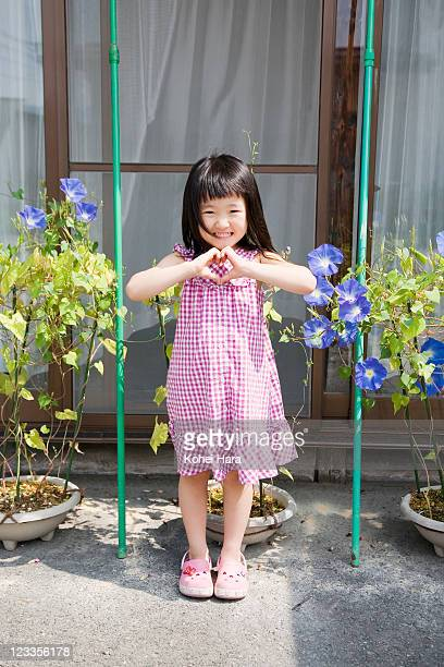 a girl and flowers at garden