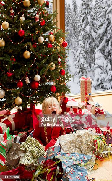 a girl crying after opening Christmas gifts