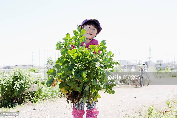 a girl doing farm work