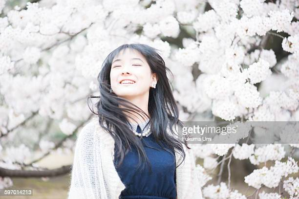 a girl in cherry blossoms park