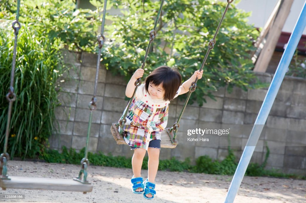 a girl playing at park : Stock Photo