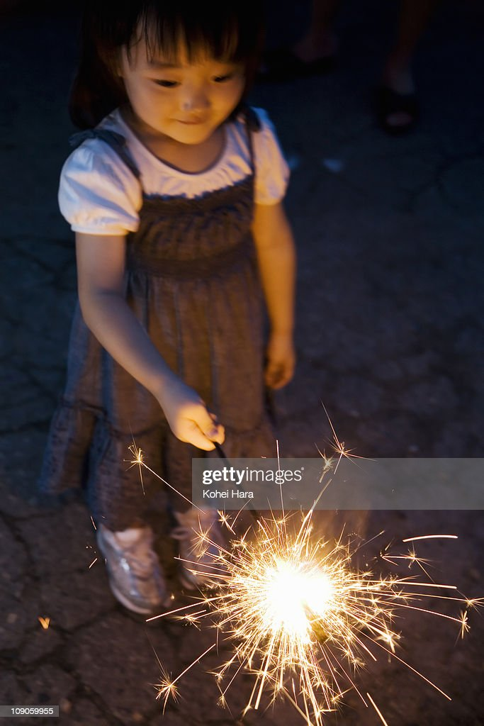 a girl playing small fireworks : Stock Photo
