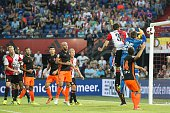 a goal of Eric Botteghin of Feyenoord is rejected by a faul at goalkeeper Matthew Ryan of Valencia CF during the preseason friendly match between...
