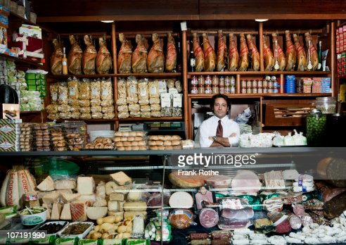 a grocer behind his counter in his shop : ストックフォト