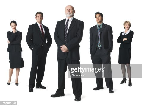 a group of business people line up in a row and look sternly into the camera : Stock Photo
