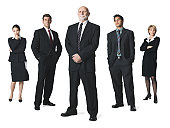 a group of business people line up in a row and look sternly into the camera