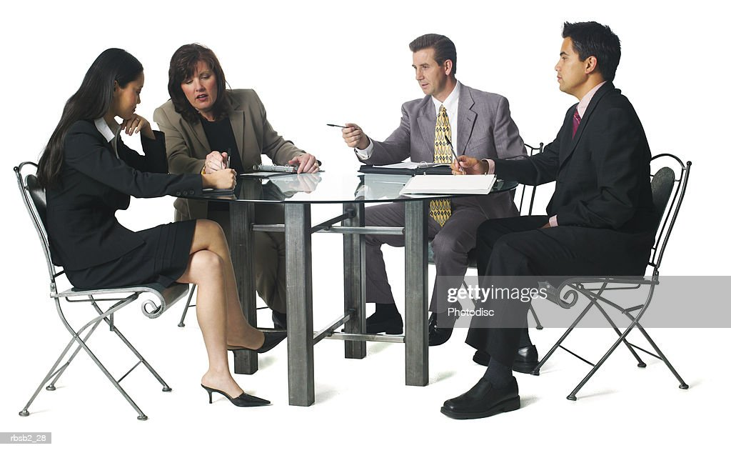 A Group Of Business People Sit Around A Table For A Staff Meeting : Stock  Photo