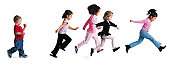 a group of girls run forward as a little boy strolls slowly behind them