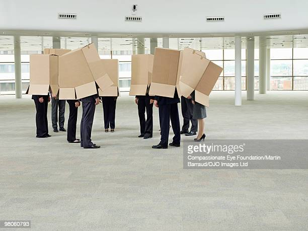 a group of people with boxes on their heads