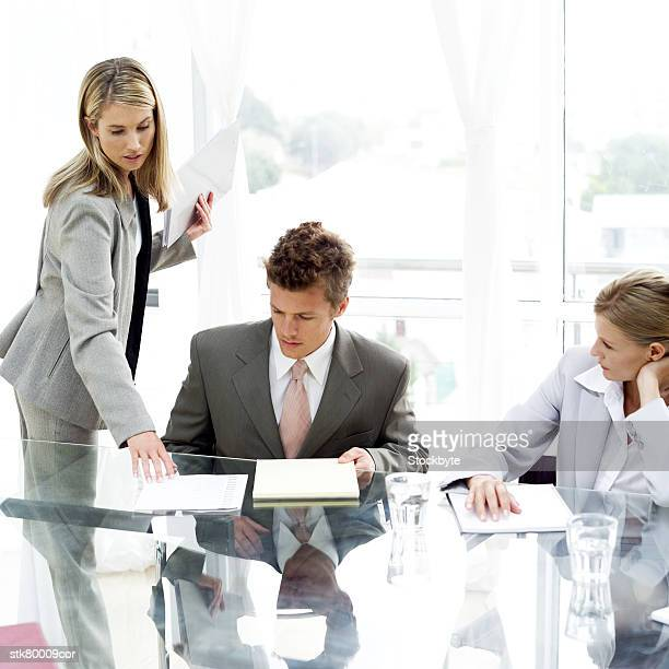 a group of young business executives working in a meeting room