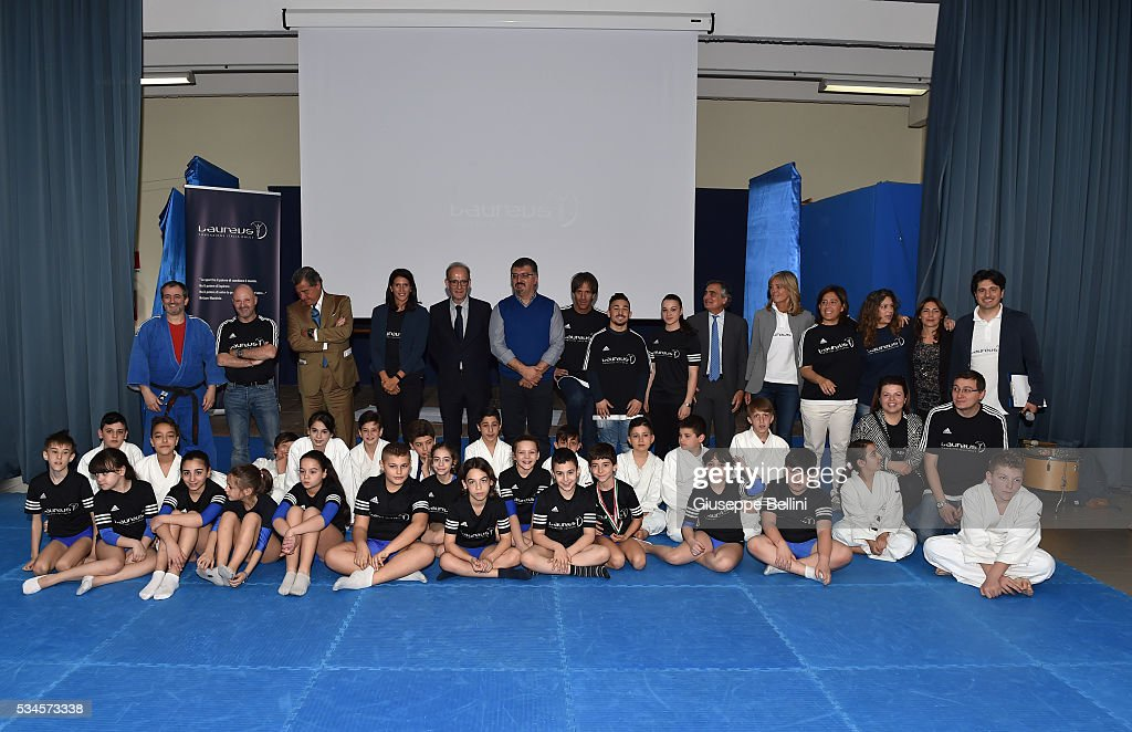 a group photo including Luareus ambassadors Davide Oldani, Miki Biasion and Alice Ronchetti is taken during the Laureus Project Visit in Naples on May 25, 2016 in Naples, Italy.