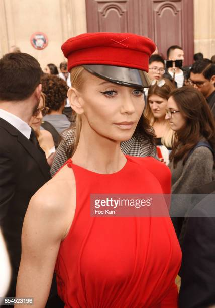 a guest attends the Christian Dior show as part of the Paris Fashion Week Womenswear Spring/Summer 2018 on September 26 2017 in Paris France