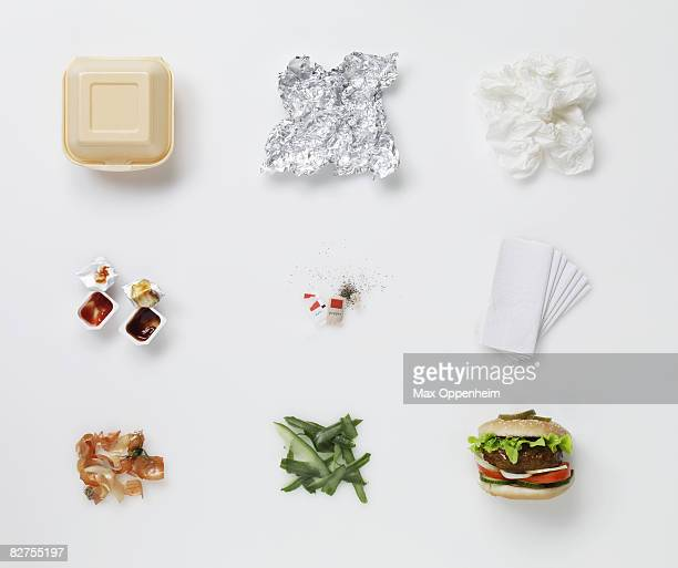 a hamburger aligned with all its associated waste