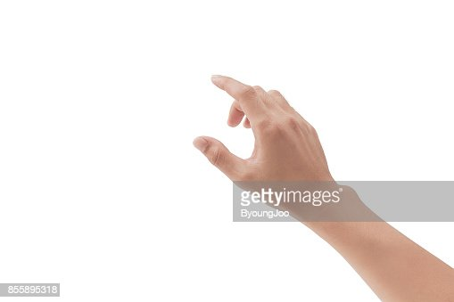 a hand touching something like a button or display device on white backgrounds, isolated : Foto de stock