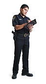 a hispanic male police officer stands as he writes a ticket