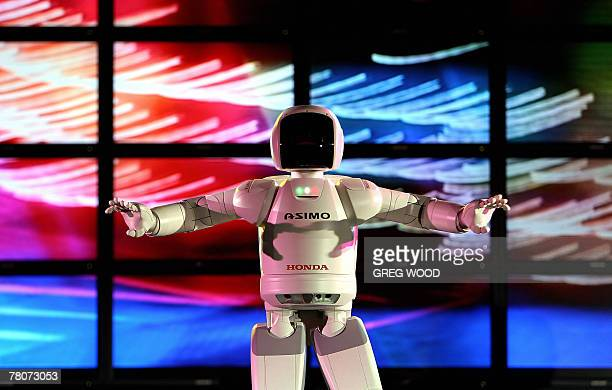 ASIMO a humanoid robot developed by Honda dances on stage in Sydney 21 November 2007 as part of an extensive show tour around Australia ASIMO whose...