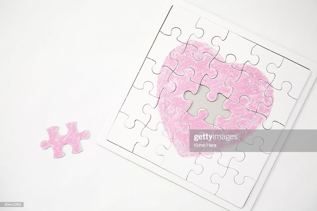 a jigsaw puzzle of heart : Stock Photo