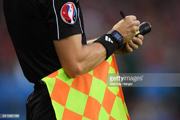 a linesman holds his flag during the UEFA EURO 2016 Group F match between Portugal and Austria at Parc des Princes on June 18 2016 in Paris France