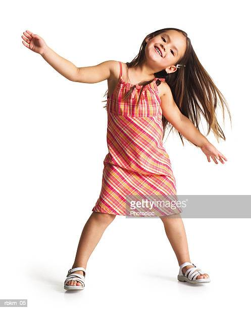 a little ethnic girl dances crazily as she tosses her body and her hair to one side