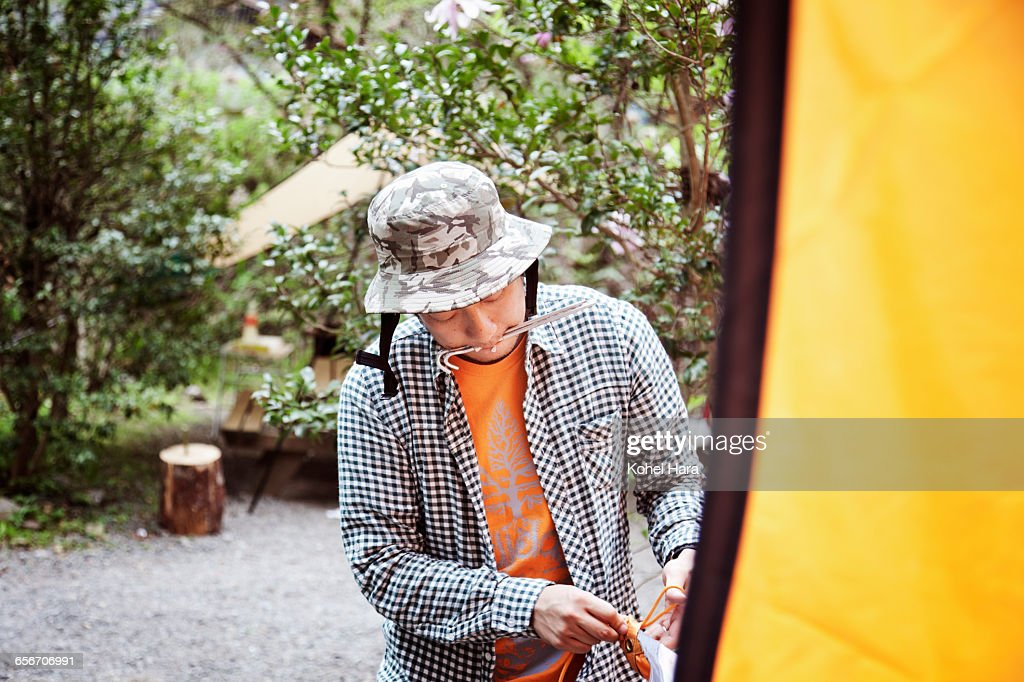 a man camping in the mountain