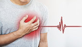 a man touching his heart, with heart pulse sign. Heart attack, and others heart disease