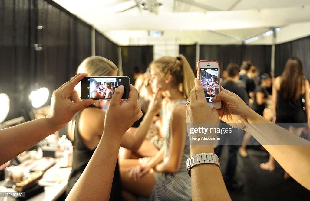 a model prepares backstage at Caffe Swimwear fashion show during MercedesBenz Fashion Week Swim 2015 at Cabana Grande at The Raleigh on July 20 2014...