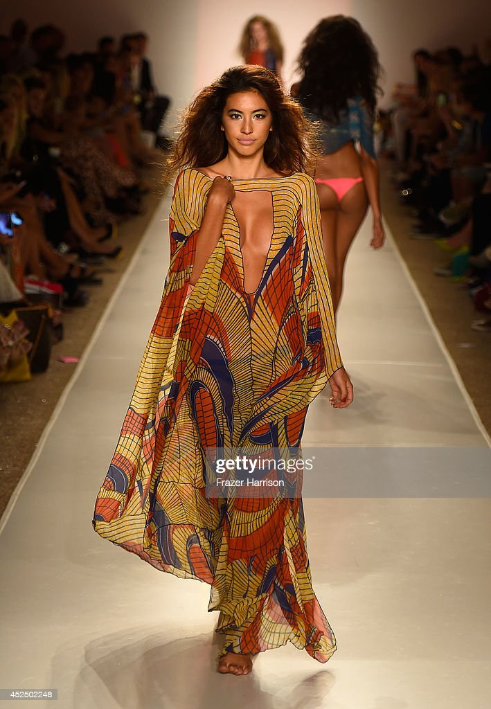 a model walks the runway during Indah show at Mercedes-Benz Fashion Week Swim 2015 at Cabana Grande at the Raleigh on July 21, 2014 in Miami, Florida.